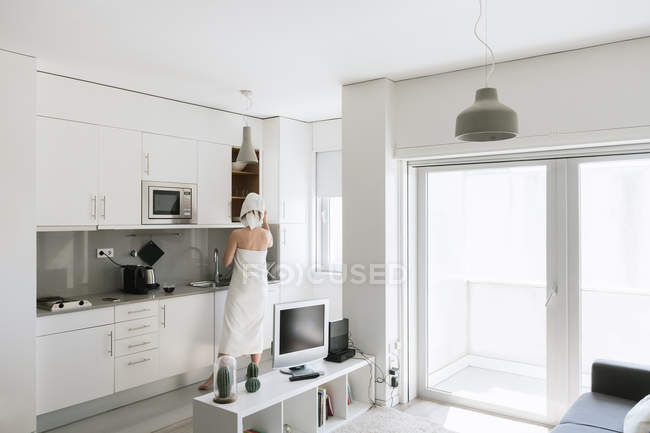 Woman taking from top on kitchen — Stock Photo