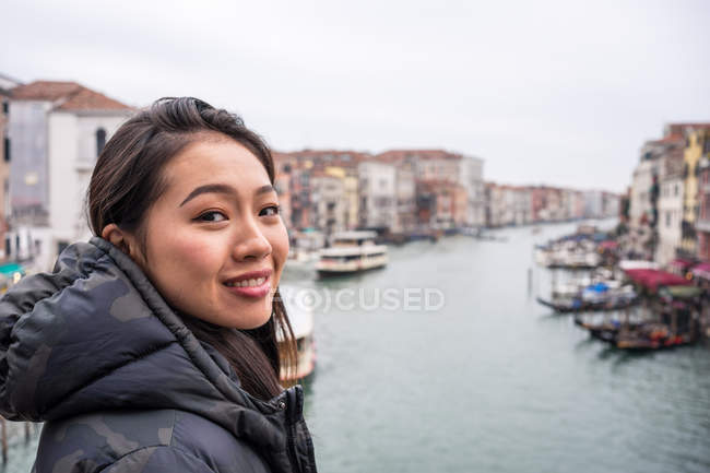 Satisfied Asian resting woman exploring old city with waterways — Stock Photo