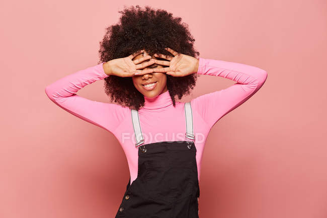 Young African American woman covering eyes with hands — Stock Photo