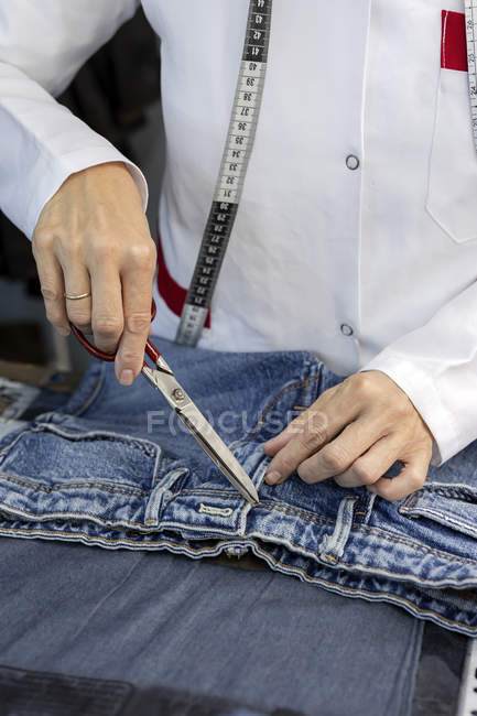 Cropped image of worker in textile factory checking the quality of the garments. Industrial production — Stock Photo