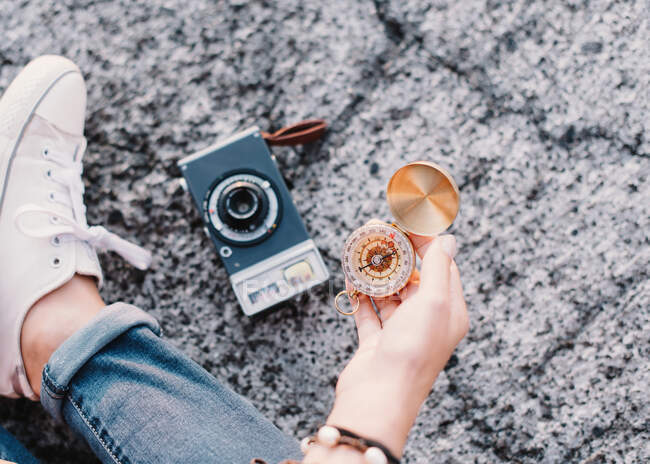 Woman with photo camera and compass — Stock Photo