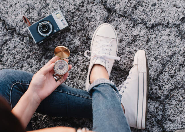 Woman with photo camera and compass — стокове фото