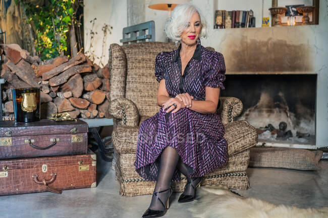 Gorgeous senior woman in living room of country house in vintage style — Stock Photo