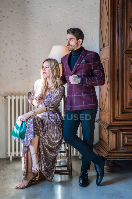 Calm pensive couple against vintage interior in country house — Stock Photo