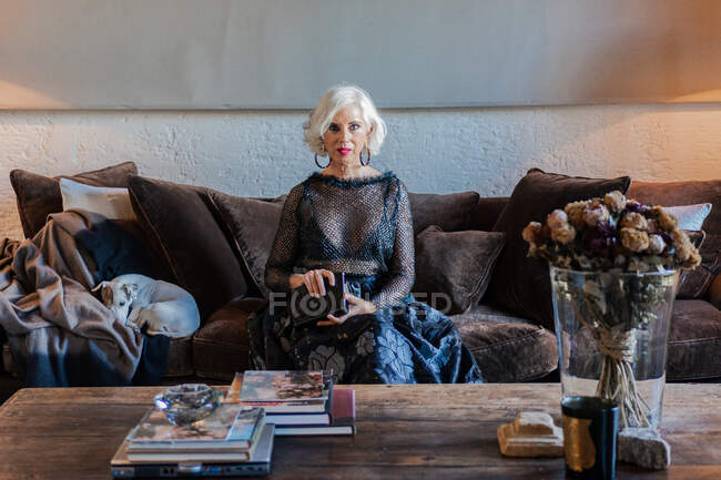 Elegant senior lady in luxurious clothes among vintage interior at home — Stock Photo