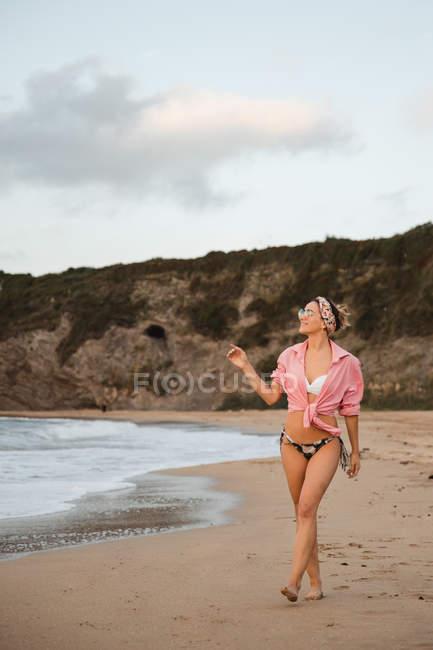 Stylish woman resting on seashore — Stock Photo