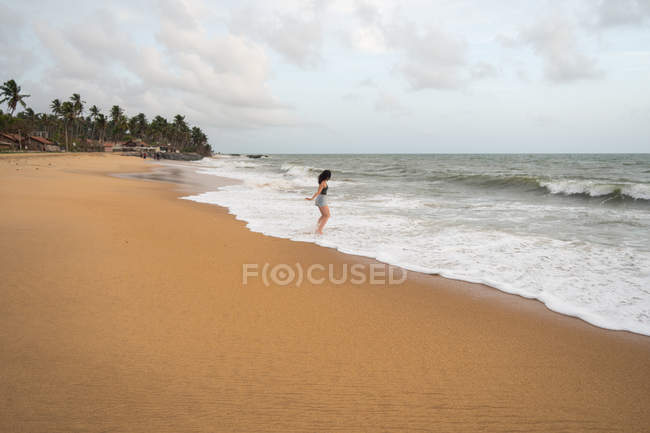 Peaceful woman at lonely seaside — Stock Photo