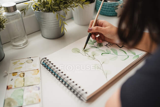 Faceless female artist painting with watercolors at home — Stock Photo