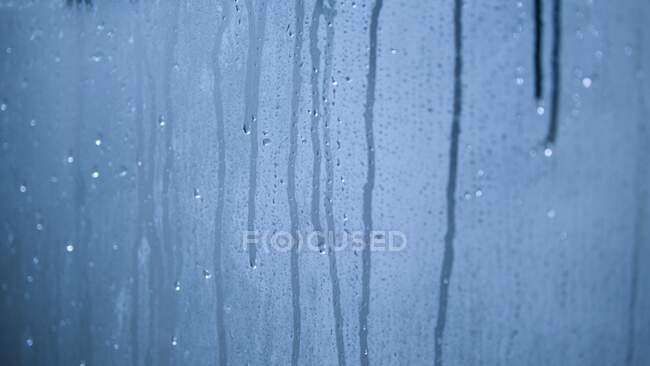 Drops of water on blue background — Stock Photo