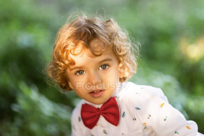 Overjoyed male child having fun in green park — Stock Photo