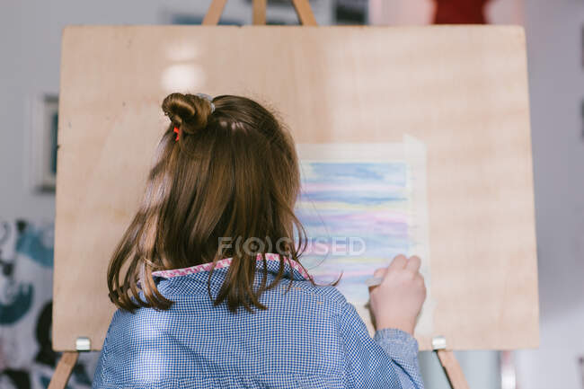 Child drawing on canvas — Stock Photo