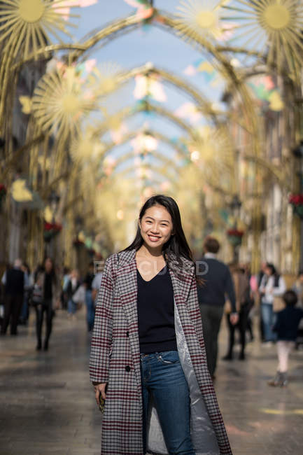 Happy young woman on street in downtown — Stock Photo