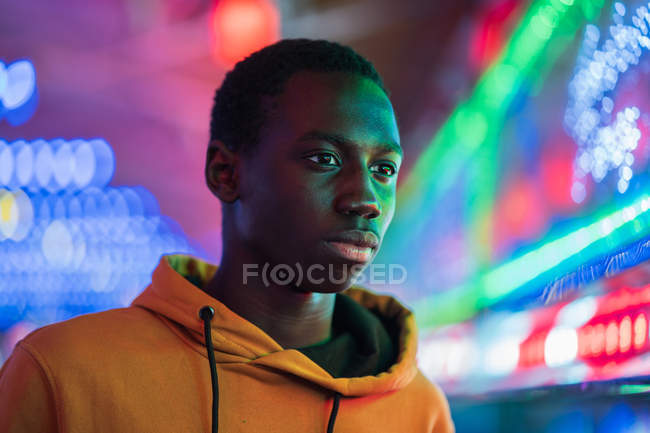 African American guy on funfair — Stock Photo