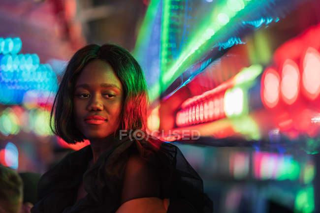Cheerful black woman on funfair — Stock Photo
