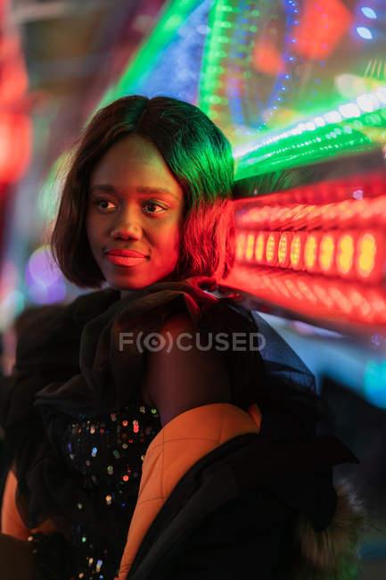 Cheerful black woman on funfair — Stock Photo