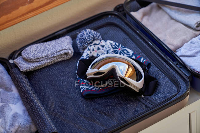 Suitcases packet for winter vacation — Stock Photo