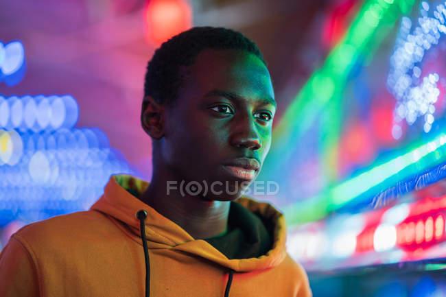 African American guy on funfair — Stock Photo