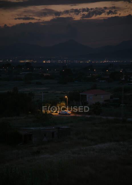 Rural city by night summer — Stockfoto
