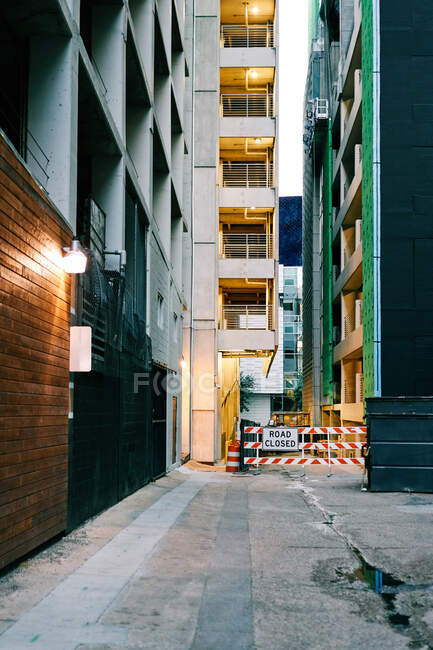 Narrow covered empty street with asphalt road among modern colorful buildings at downtown — Stock Photo