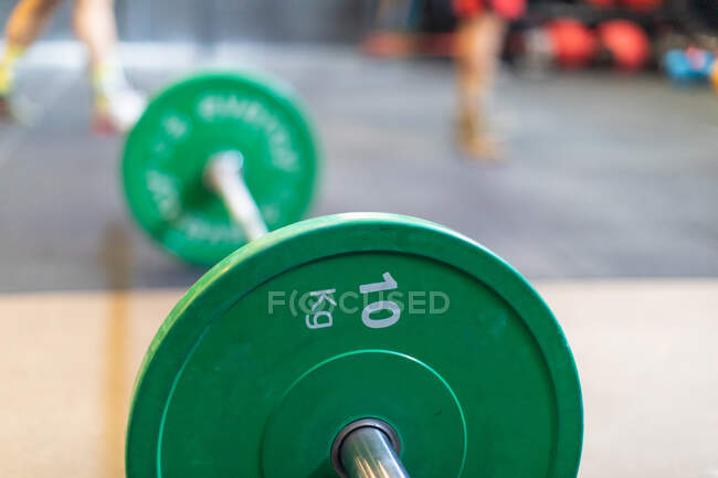 Barbell with weights on floor — Stock Photo