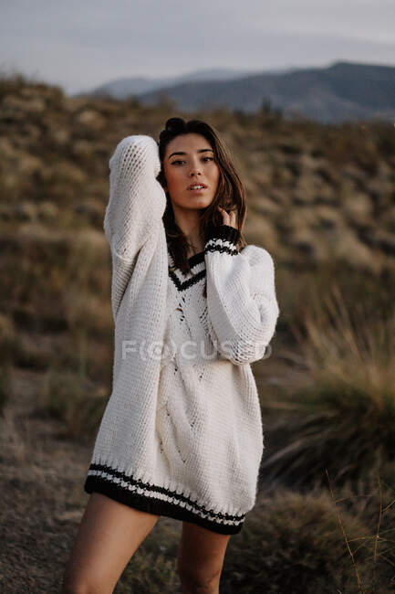Sensual young woman in rural landscape — Stock Photo