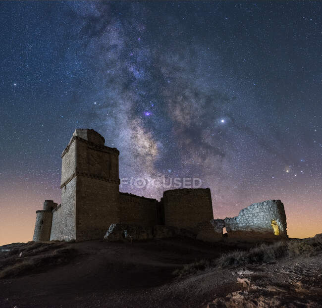 From below picturesque scenery of abandoned remains of ancient castle under Milky Way — Stock Photo