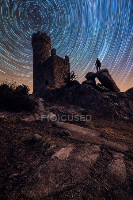 Picturesque scenery of ancient abandoned destroyed castle under colorful starry sky at night — Stock Photo