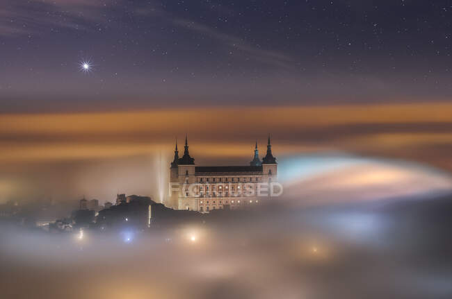 From above wonderful landscape of medieval castle built over city in misty colorful sunrise — Stock Photo