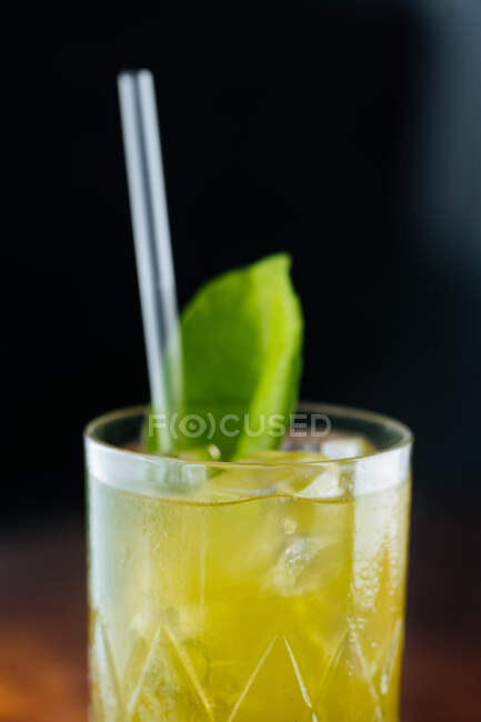 Tasty appetizing chilled lemonade with mint and straw on table in sunlight — Stock Photo