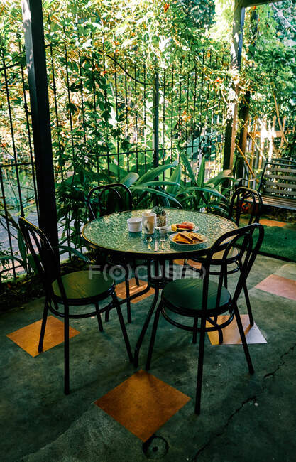 Healthy breakfast food placed on round table on terrace of outdoor restaurant in morning in Costa Rica — Stock Photo