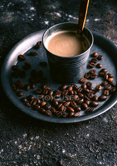 Coffee and coffee grains on tray — Stock Photo