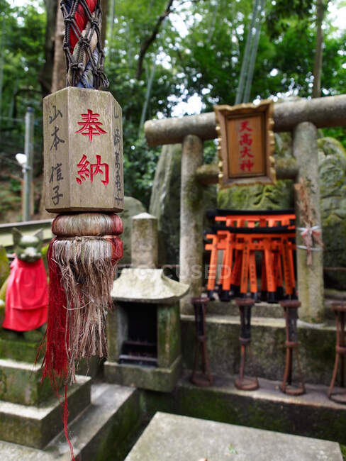 Hanging traditional stone lantern with hieroglyphic inscriptions in old Shinto shrine in Japan — Stock Photo