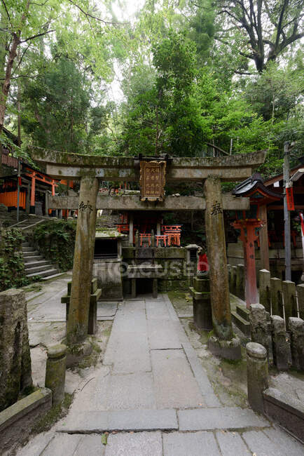 Weathered old stone construction in oriental style in green garden in Japan — Stock Photo