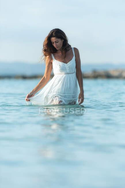 Happy woman dancing in sea water — Stock Photo