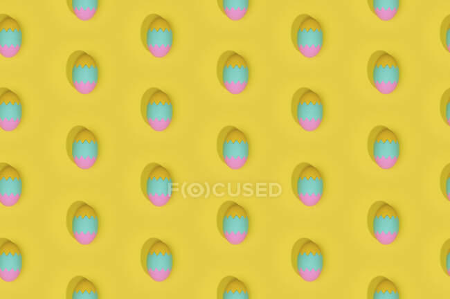 Seamless Easter pattern with colored decorated eggs arranged in rows on yellow background — Stock Photo
