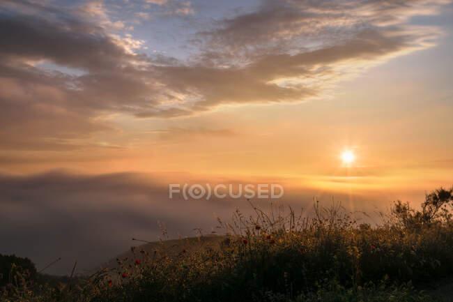 Majestic mountain range against overcast sky in nature during sundown — Stock Photo