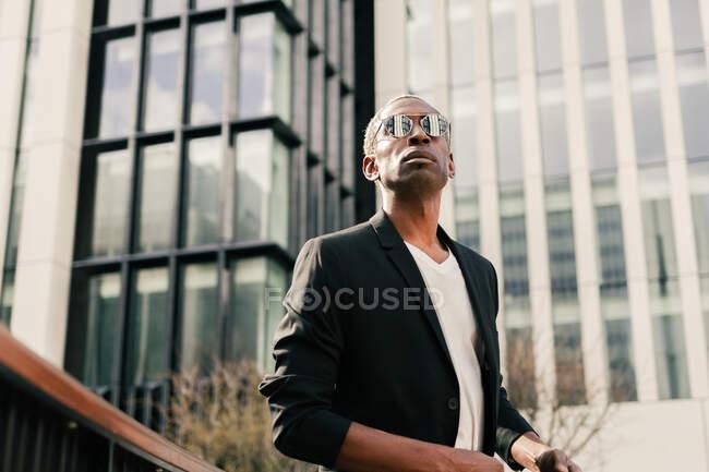 Stylish black businessman on street — Stock Photo