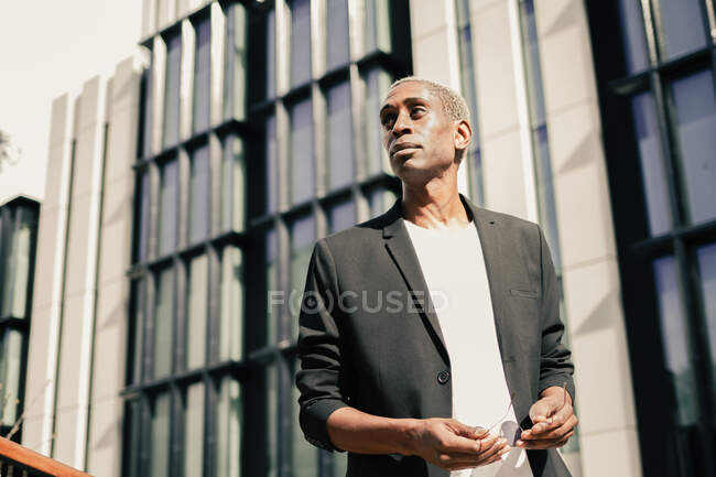 Stylish black businessman on street — Stock Photo