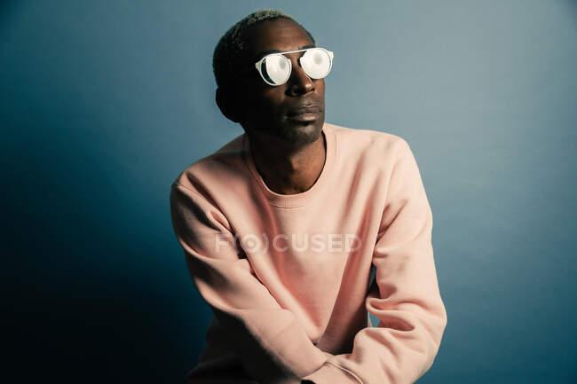 Black man in stylish sweatshirt — Stock Photo