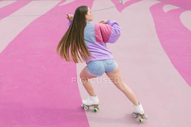 Stylish teenager skating on playground — Stock Photo