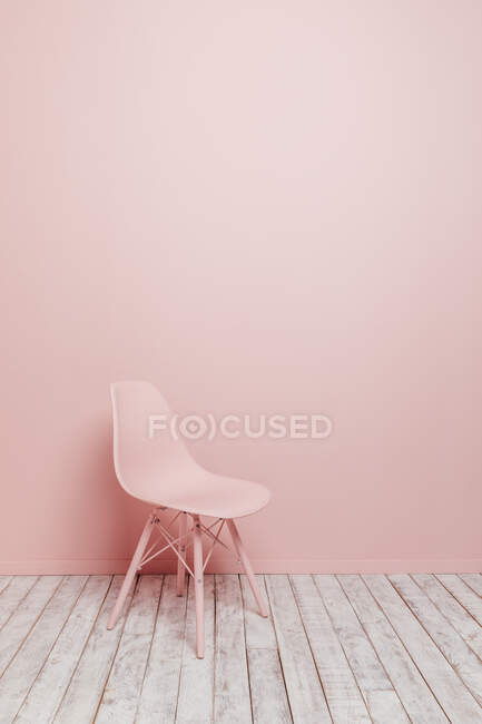Side view of a single design pink chair on a pink background — Stock Photo