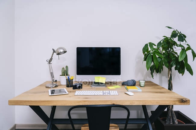 Modern creative home workspace with computer — Stock Photo
