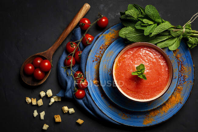Healthy Homemade Tomato Soup with Bread, Mint and Olive Oil on Dark Background from above. Vegan food concept — Stock Photo