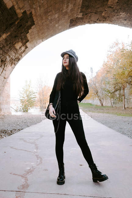 Trendy young woman in park — Stock Photo