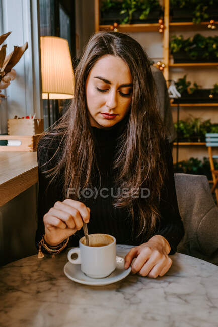 Woman drinking coffee in cafe — Stock Photo