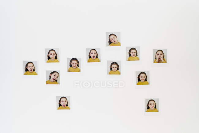White wall with different photos that reflect the different expressions of a girl's face. — Stock Photo