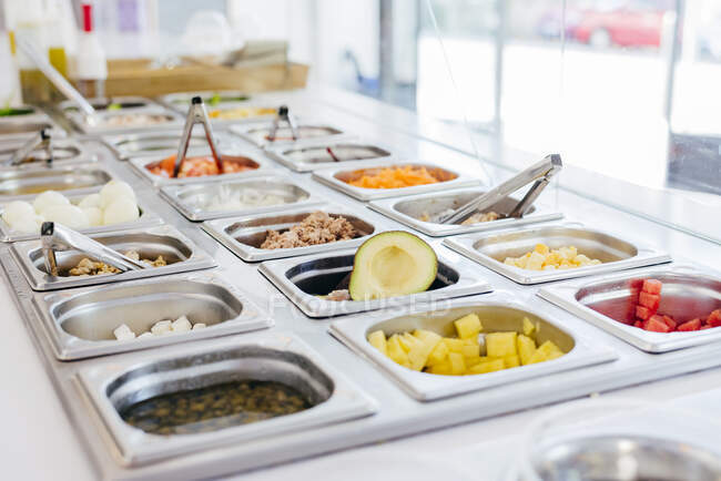 Modern restaurant with self service system and served delicious foods and dishes in metal warm container on counter — Stock Photo