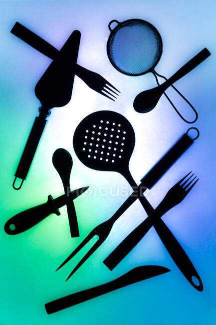 Composition of kitchen supplies on colorful background — Stock Photo