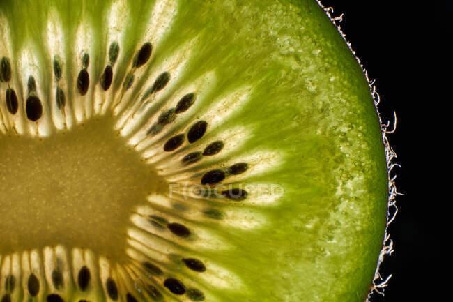 Half of fresh kiwi with seeds — Stock Photo