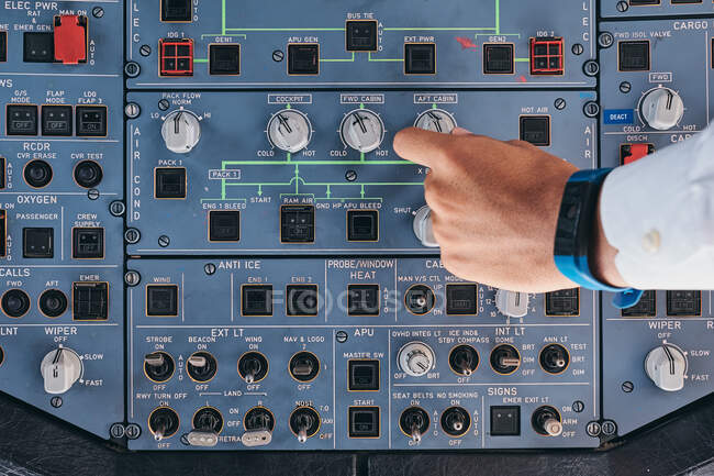 Pilot working with control console during flight — Stock Photo